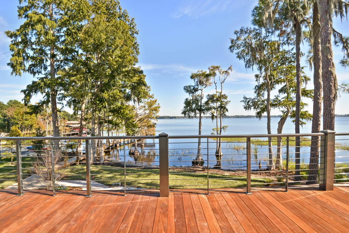 Lakeside Treehouse exterior by Brianna Michelle Design